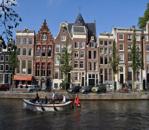 Coffeeshop boat tour - leaning canal houses
